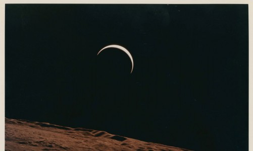 Lot 558, Crescent Earth rising beyond the Moon's barren horizon, July 26- August 7, 1971, taken by Apollo 15 crew member Alfred Worden, one of the space photographs in a collection up for auction at Christie's, is seen in this handout image. Alfred Worden/Christie's/Handout via REUTERS  THIS IMAGE HAS BEEN SUPPLIED BY A THIRD PARTY. MANDATORY CREDIT. NO RESALES. NO ARCHIVES. NO NEW USES AFTER NOVEMBER 20, 2020