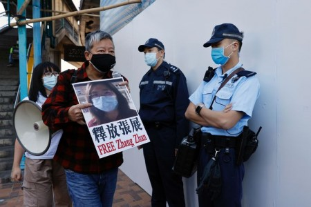 Pro-democracy supporters protest to urge for the release of 12 Hong Kong activists arrested as they reportedly sailed to Taiwan for political asylum and citizen journalist Zhang Zhan outside China's Liaison Office, in Hong Kong, China December 28, 2020. REUTERS/Tyrone Siu
