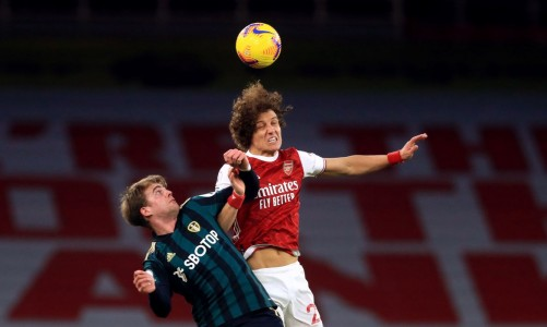 Leeds United's Patrick Bamford (L) and Arsenal's David Luiz battle for the ball during the English Premier League soccer match between Arsenal and Leeds United at The Emirates Stadium.
