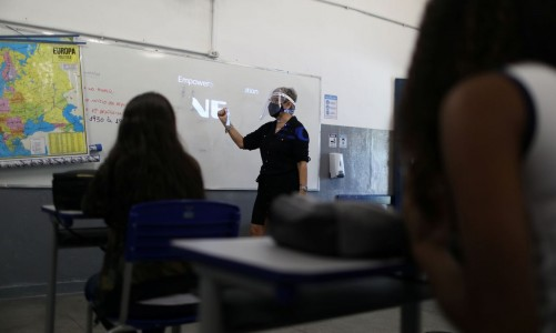 A teacher gives lessons to students at Aplicacao Carioca Coelho Neto municipal school as some schools continue with the gradual reopening, amid the coronavirus disease (COVID-19) outbreak, in Rio de Janeiro, Brazil November 24, 2020. REUTERS/Pilar Olivares