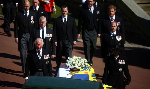 The hearse, a specially modified Land Rover, Britain's Prince Charles and members of the Royal Family walk near St George's Chapel during the funeral of Britain's Prince Philip, husband of Queen Elizabeth, who died at the age of 99, on the grounds of Windsor Castle in Windsor, Britain, April 17, 2021. REUTERS/Hannah McKay/Pool TPX IMAGES OF THE DAY